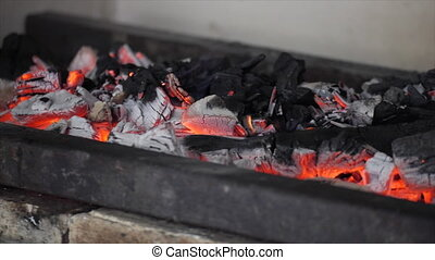 hot coals in the grill. burning wood in a brazier. panorama left to right.