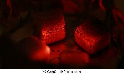 Hot coals in the hookah bowl in the dark