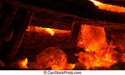 Hot coals in the old stove. Hot red coals in a vintage clay ...