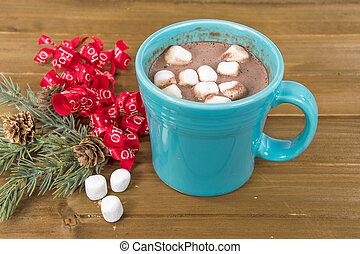 hot cocoa drink with Christmas ribbon