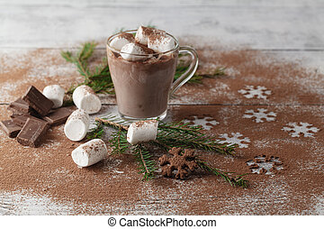 Hot cocoa with marshmallows and christmas decoration on white wooden background