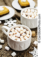 hot cocoa with mini marshmallows. toning. selective focus