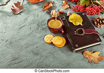 Hot coffee and book with yellow leaves