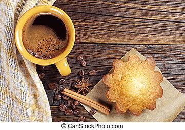 Hot coffee and cupcake