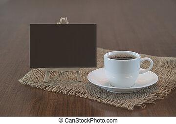 Hot coffee cup and blank blackboard