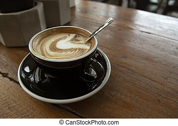Hot coffee cup on the wooden table