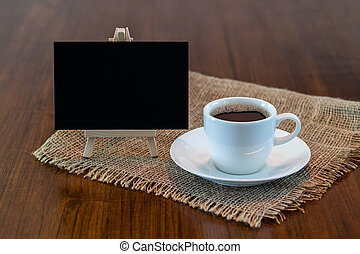 Hot coffee cup with blank blackboard