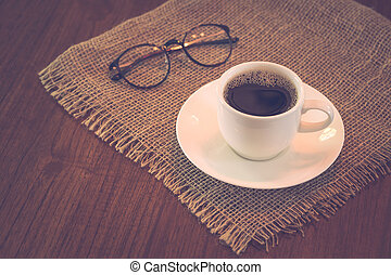 Hot coffee cup with glasses retro color filltered