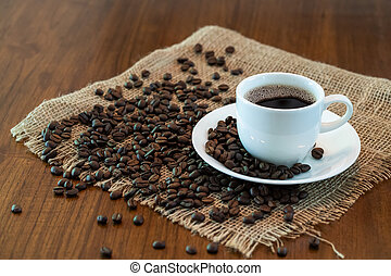 Hot coffee cup with roasted coffee beans