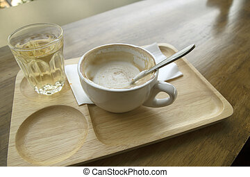 Hot coffee in a cup and tea mug on a wooden table