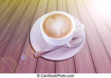 Hot coffee in white cup on wood background.