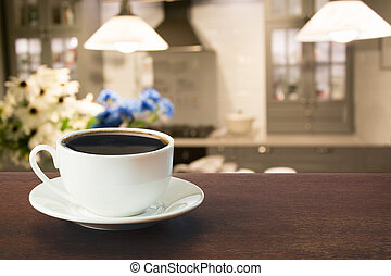 Hot coffee on tabletop in modern kitchen.
