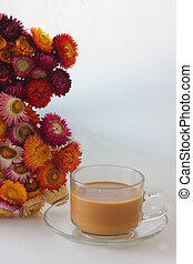 Hot coffee with dried flowers