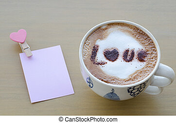 hot coffee with foam milk art love pattern