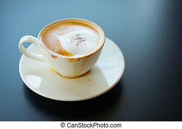 hot coffee with foam milk art of love