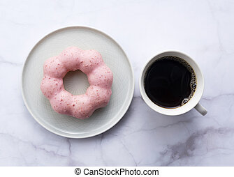 Hot coffee with pink donuts on a marble background