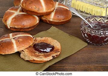 hot cross bun with strawberry jam