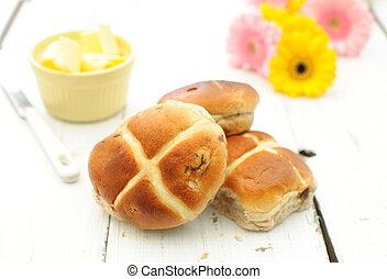 Hot cross buns - Freshly baked hot cross buns on a kitchen...