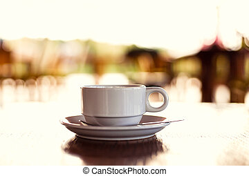 hot cup of coffee on the wood table in the morning.