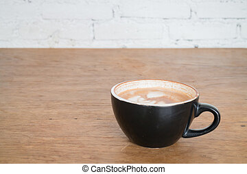 Hot cup of coffee on wooden table