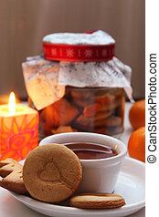 Hot cup of tea with handmade cookies