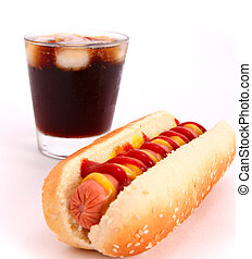 hot dog and drink - black drink and hot dog over lettuce...