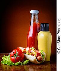 hot dog, vegetables, ketchup and mustard
