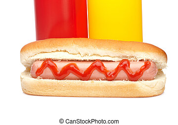 Hot dog with ketchup and mustard bottles