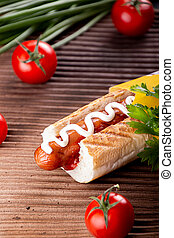 Hot dogs, cherry tomatoes on rustic background. Fast food, american tradditional