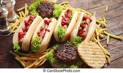 Hot dogs, hamburgers and french fries. Composition of fast...