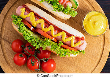 Hot dogs on wooden background. Top view, food flat lay. Fast food concept