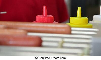 Hot dogs roller maker in hotdog diner