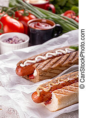 Hot dogs, tomatoes on white background. Fast food, american tradditional meal