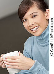 Hot Drink - A beautiful young oriental woman with a ...