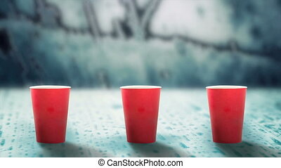 hot drink evaporating smoke on melting ice - red cups of hot...