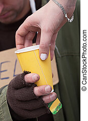 Hot drink for a beggar - Hot drink for a homeless beggar,...