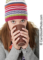 Hot drink - Young woman in winter hat with cup of hot ...
