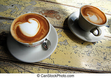 Hot Flat White Coffee Drinks in a Cafe - Cups of hot flat...