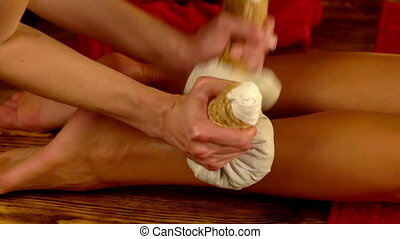 Hot foot poultice massage in spa salon. Slow motion.