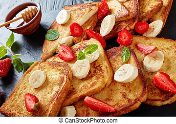 hot French toasts on slate board