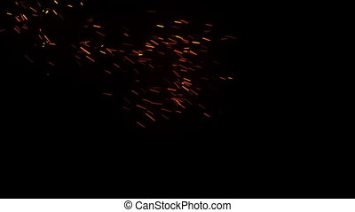 Hot glowing embers. Glittering particles sparkle