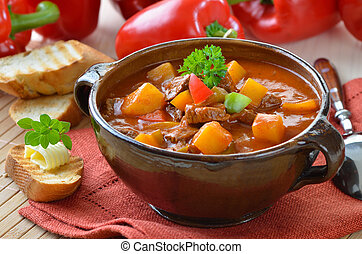 Typical Hungarian goulash soup with baguette