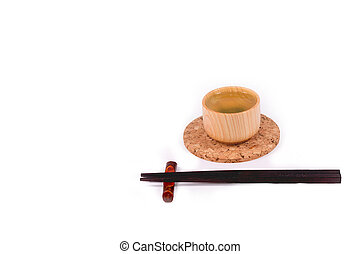 Hot green tea and Chopsticks on white background with clipping path.