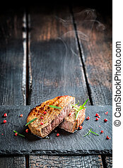 Hot grilled meat with fresh rosemary