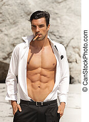 Hot guy - Sexy male model in open shirt exposing great toned...