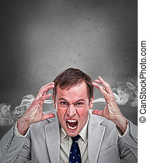 Hot headed business man shouting on grey background with...