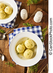 Hot Homemade Matzo Ball Soup in a Bowl
