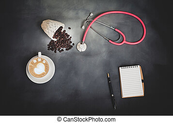 hot late art with coffee beans and stethoscope on background.