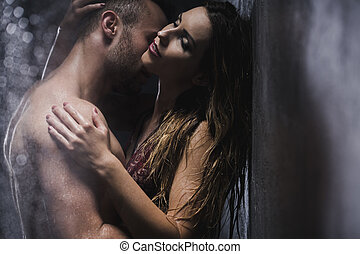 Hot love under shower - Sexy couple embracing and kissing...