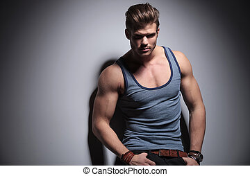 hot man looks at you - handsome young man posing with his...